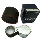 กล้องส่องพระ Leika 10x18mm ( สีเงินหุ้มยาง )