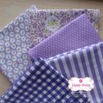 Set 5 ชิ้น : ผ้าคอตตอน100% โทนสีม่วง 4 ลาย และผ้าแคนวาสลายตาราง แต่ละชิ้นขนาด1/8 ม.(50x27.5ซม.)