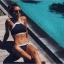 Bikini แบบคล้องคอ สีพื้นตัดขอบด้วยเส้นกำลังดี แบบยอดฮิตแบบสาวยุโรปใส่กัน thumbnail 3
