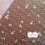 ผ้าคอตตอนไทย 100% 1/4 ม.(50x55ซม.)ลายน้องซู พื้นสีน้ำตาล thumbnail 1