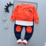 ชุดเซ็ตเด็กผ้ายืดเสื้อส้ม กางเกงสีดำวงส้มหัวเข่า
