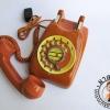 โทรศัพท์แป้นหมุนเก่าสีส้ม